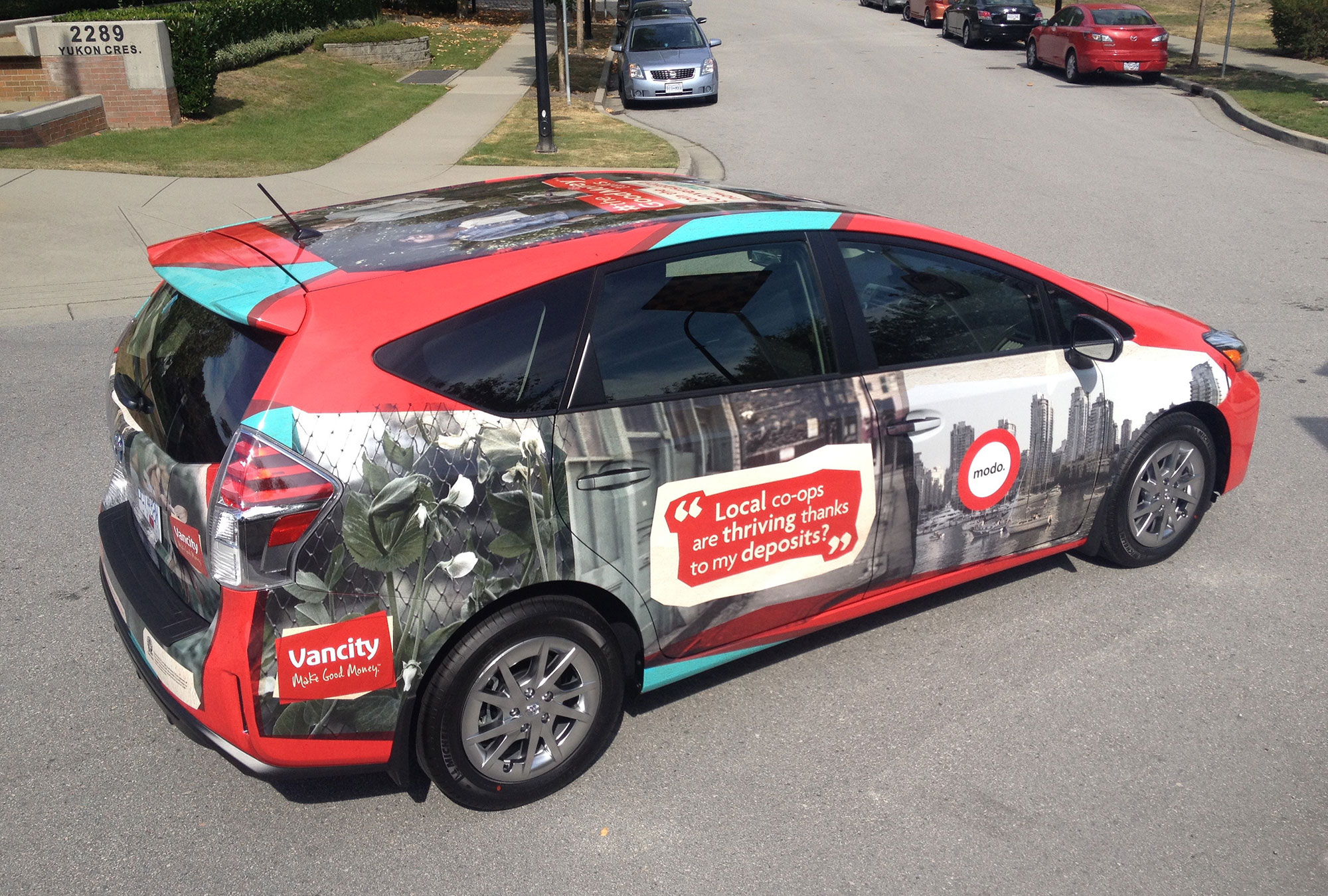 Red hatchback car with full graphic wrap